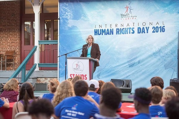 Ms. Holt speaking at International Human Rights Day about the many human rights violations that occur every day in our society                     such as human trafficking, bullying, and economic inequality